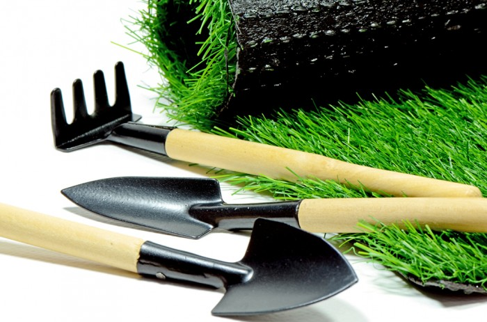 Small Gardening Tools and Artificial Turf Isolated on White Background.